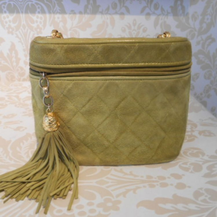 ec748212b316 LXRandCo guarantees this is an authentic vintage Chanel Green Suede Fringed  Chanel Bag shoulder bag. This signature pocketbook was crafted in leather  in ...