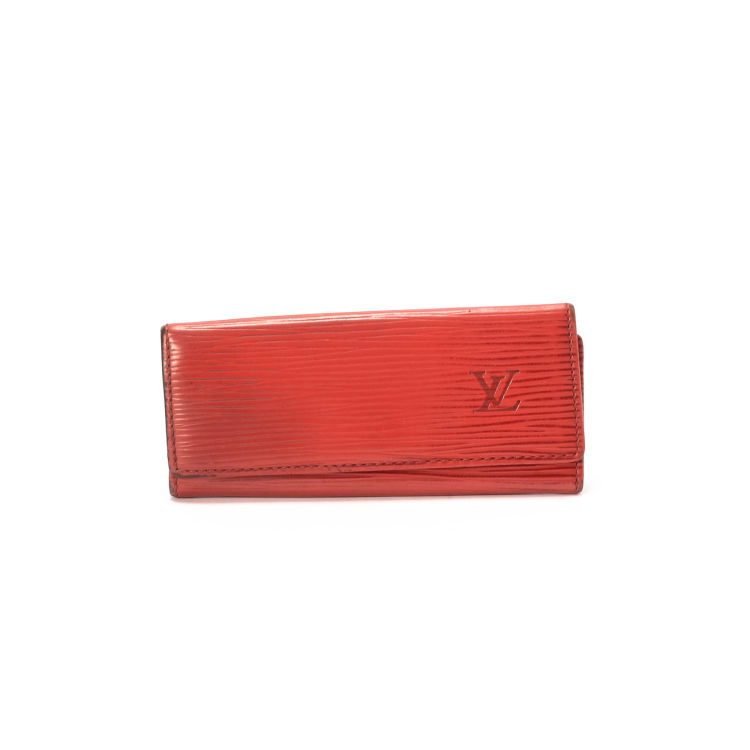 af56443d09e1 LXRandCo guarantees the authenticity of this vintage Louis Vuitton key  holder. Crafted in epi leather