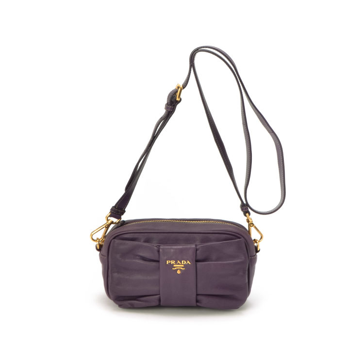 2963dc399419 LXRandCo guarantees the authenticity of this vintage Prada Ribbon Mini Shoulder  Bag messenger   crossbody bag. This chic pocketbook was crafted in lambskin  ...