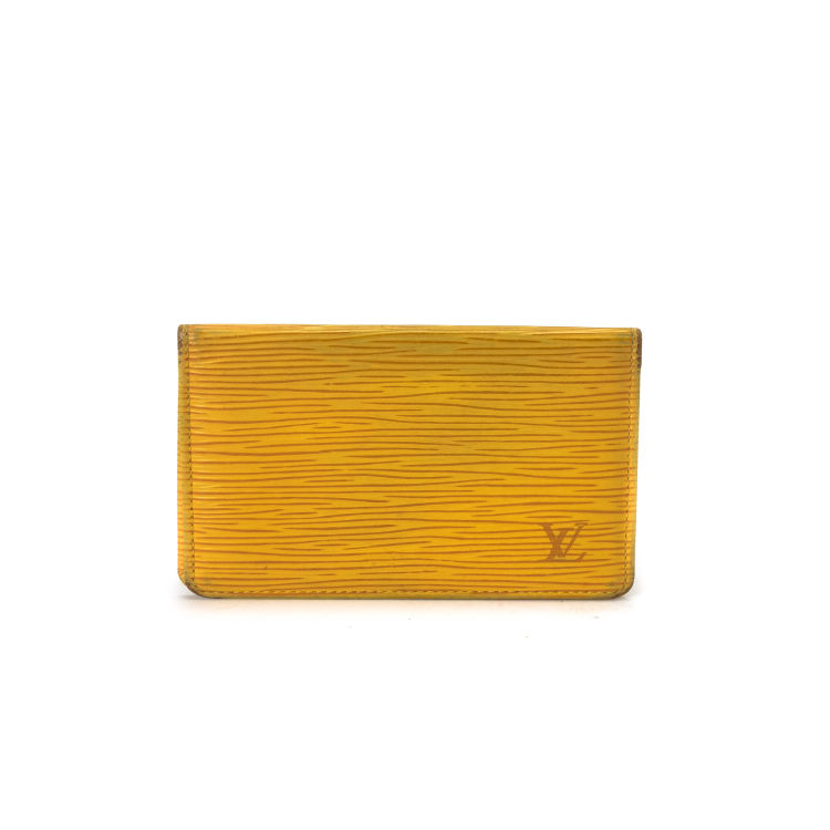 f9ce20b377d5f5 LXRandCo guarantees the authenticity of this vintage Louis Vuitton Card  Holder wallet. Crafted in epi leather, this practical compact wallet comes  in ...