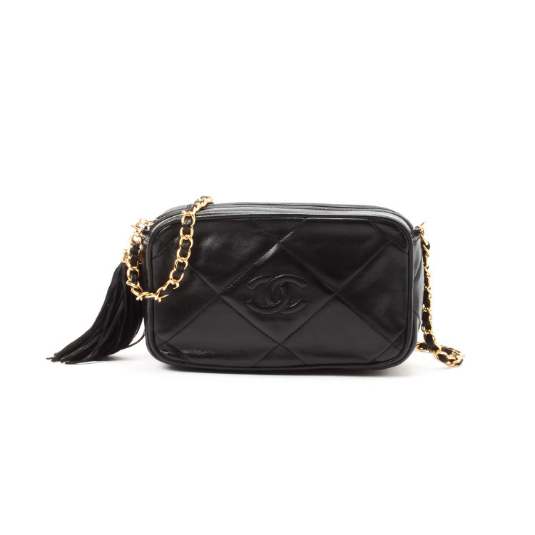 50d5dd2eebbf ... is an authentic vintage Chanel Quilted Shoulder Bag With Tassel  messenger & crossbody bag. This luxurious hobo bag was crafted in lambskin  in black.
