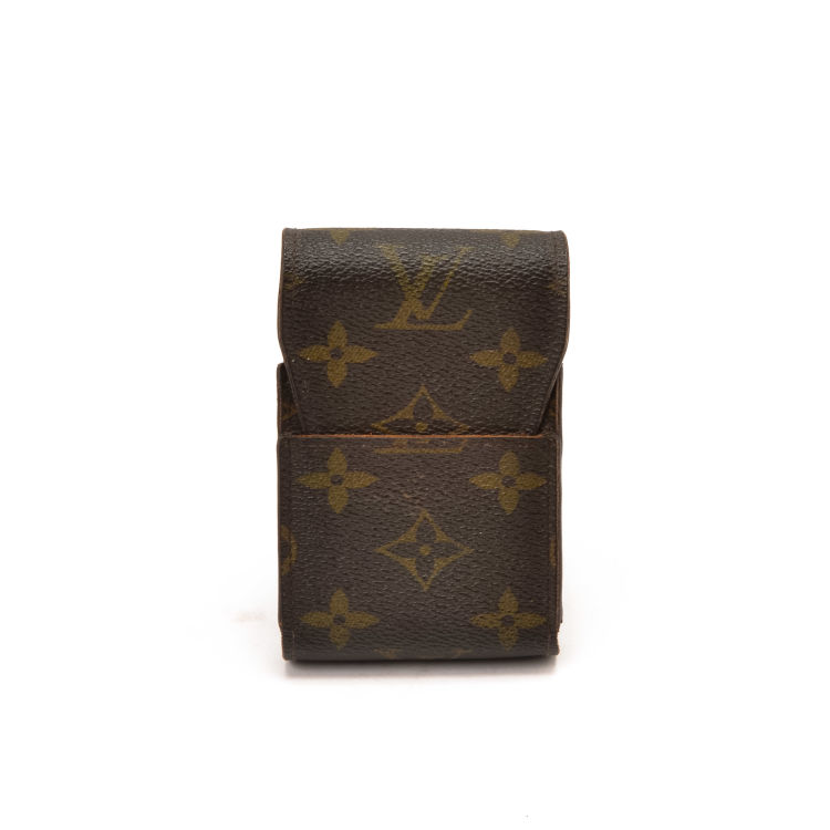 00e568c9ec6 LXRandCo guarantees this is an authentic vintage Louis Vuitton Accessory  Case wallet. This chic wallet was crafted in monogram leather in brown.