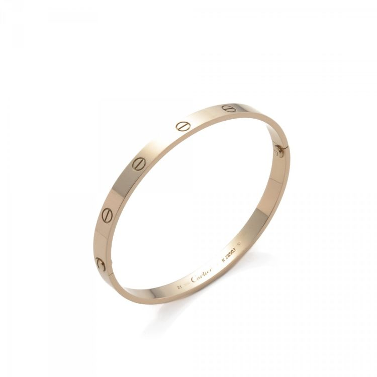 bf8a9a74847 The authenticity of this vintage Cartier Love Bracelet bracelet & bangle is  guaranteed by LXRandCo. This refined bracelet & bangle comes in beautiful  gold ...