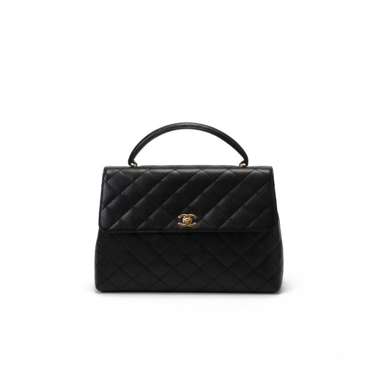 e155782d09 The authenticity of this vintage Chanel Jumbo Kelly handbag is guaranteed  by LXRandCo. This luxurious handbag in beautiful black is made in caviar  leather.