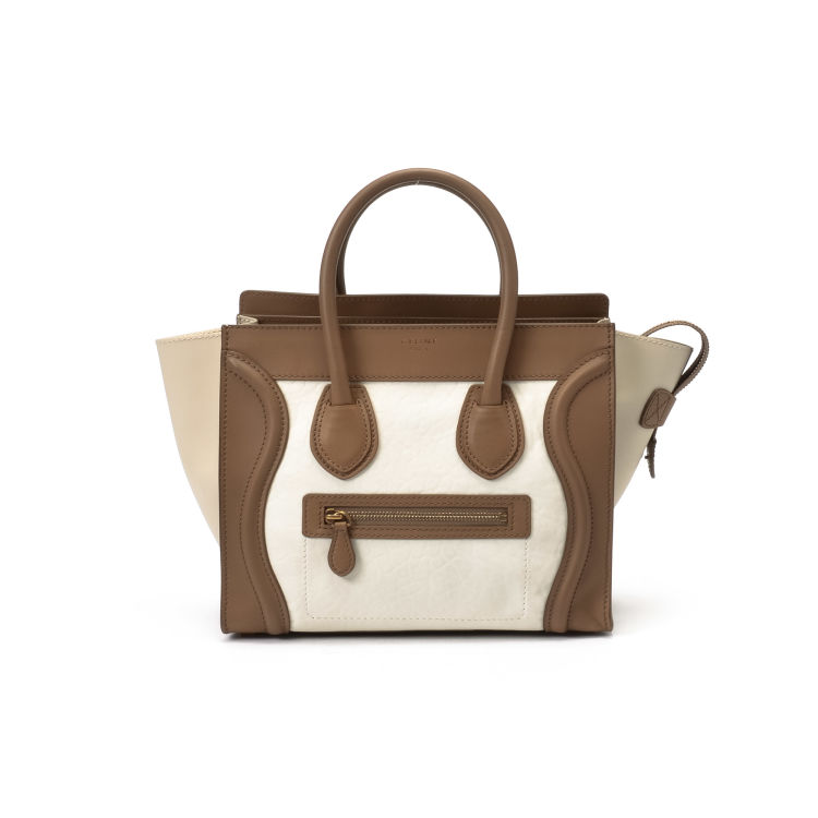 d1910ef5aebc LXRandCo guarantees this is an authentic vintage Céline Micro Luggage Bag  handbag. This stylish handbag in beautiful two tone is made of leather.