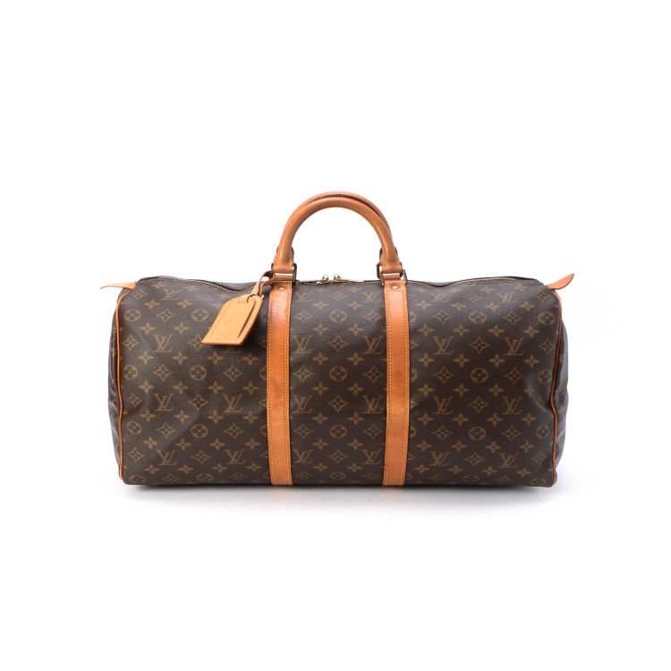 fad0bbc12c7e The authenticity of this vintage Louis Vuitton Keepall 50 travel bag is  guaranteed by LXRandCo. Crafted in monogram leather