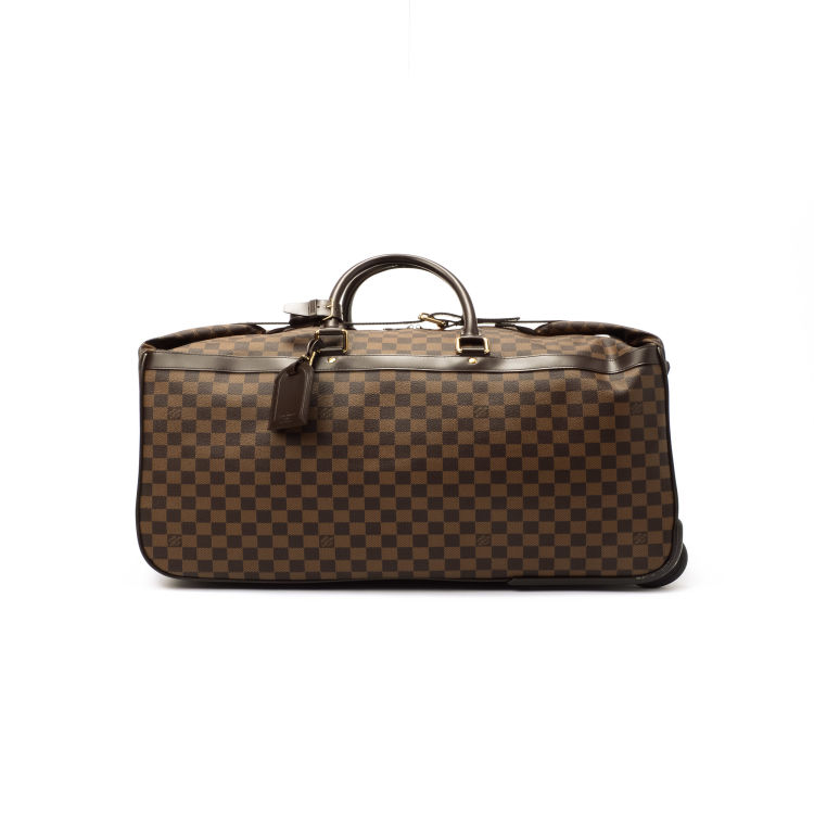 bd00a6cf869d LXRandCo guarantees the authenticity of this vintage Louis Vuitton Eole 60  travel bag. This stylish weekend bag in beautiful brown is made in damier  ebene ...