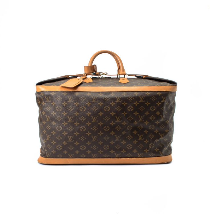 LXRandCo guarantees this is an authentic vintage Louis Vuitton Cruiser Bag  50 travel bag. This chic garment carrier in beautiful brown is made in  monogram ... d0b0591b70