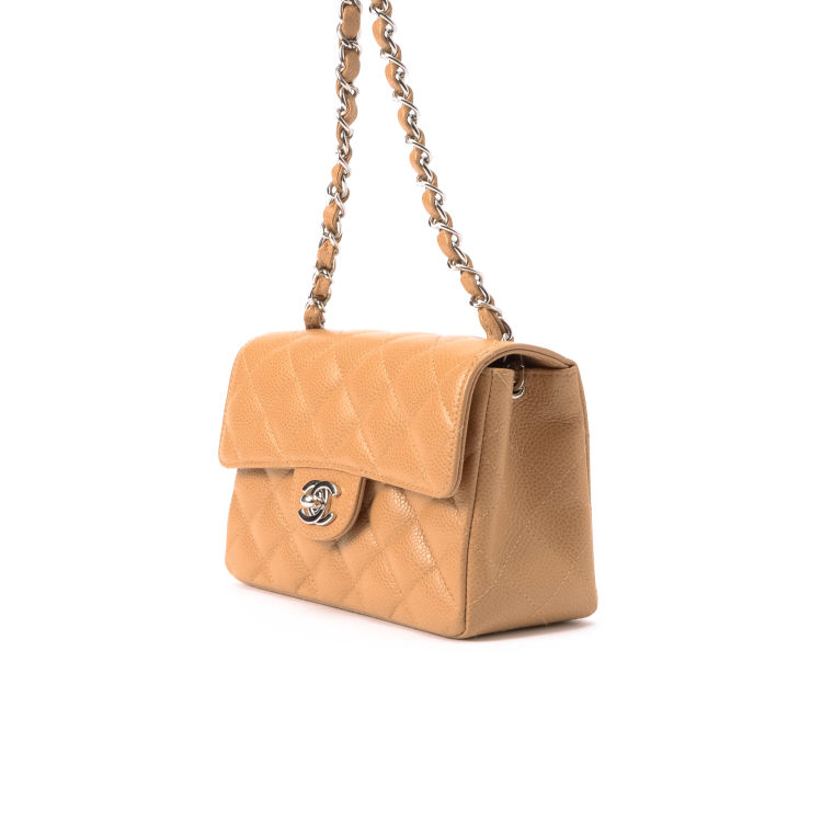 55d76779c2a6 LXRandCo guarantees this is an authentic vintage Chanel Mini Classic Flap  shoulder bag. This signature purse was crafted in caviar leather in beige.