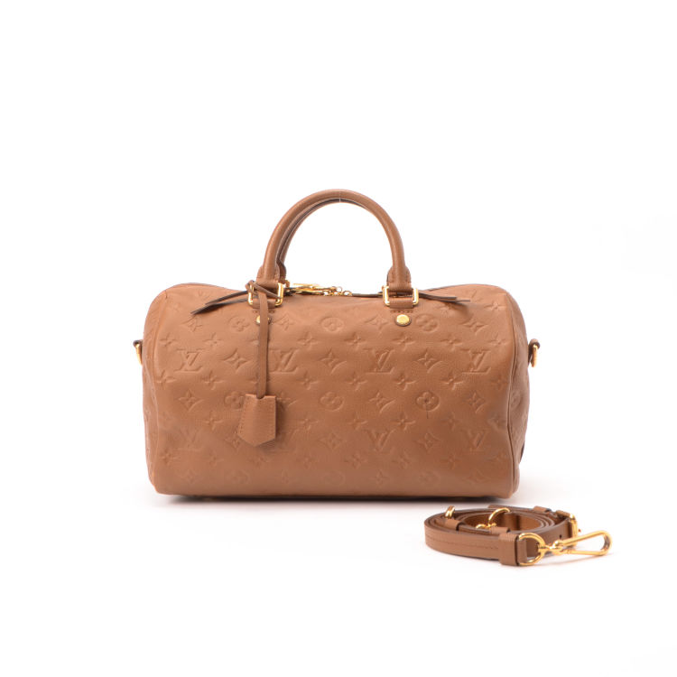 The authenticity of this vintage Louis Vuitton Speedy Bandouliere 30 handbag  is guaranteed by LXRandCo. Crafted in monogram empreinte coated canvas 9cb64c7764c79