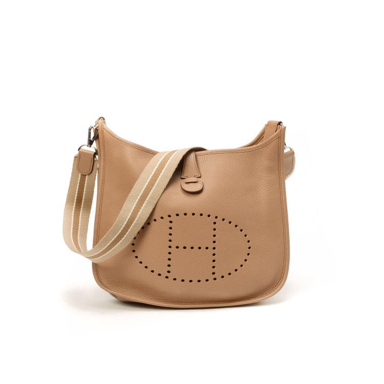79b4598b9cd4 The authenticity of this vintage Hermès Evelyne II PM messenger   crossbody  bag is guaranteed by LXRandCo. Crafted in taurillon clemence calf