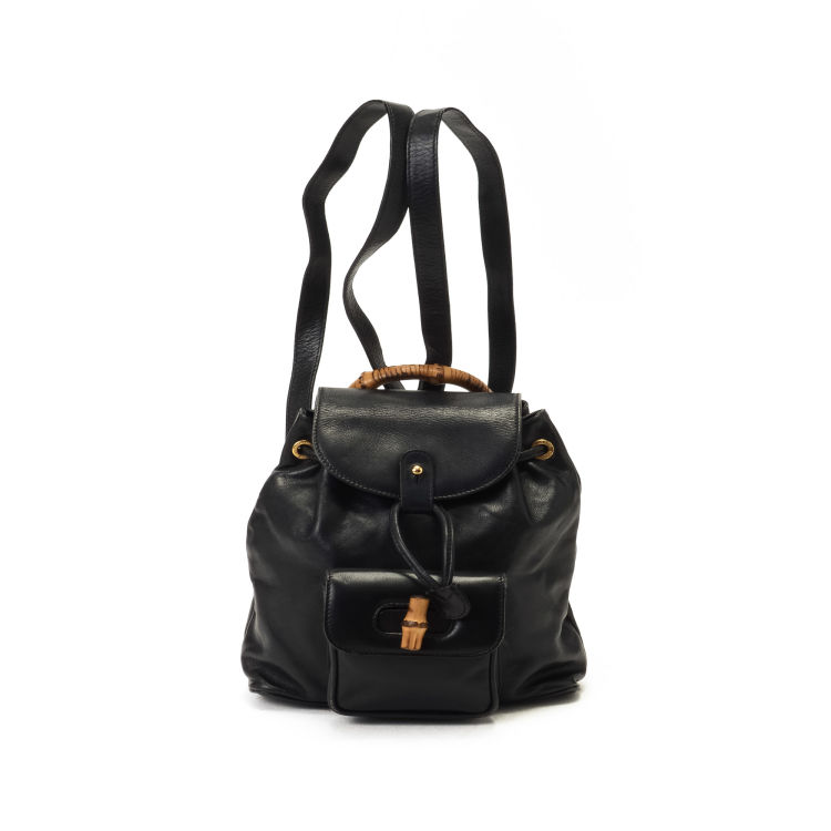 33336c53980e9d LXRandCo guarantees this is an authentic vintage Gucci Bamboo Mini Backpack  travel bag. This iconic garment bag in black is made of leather.