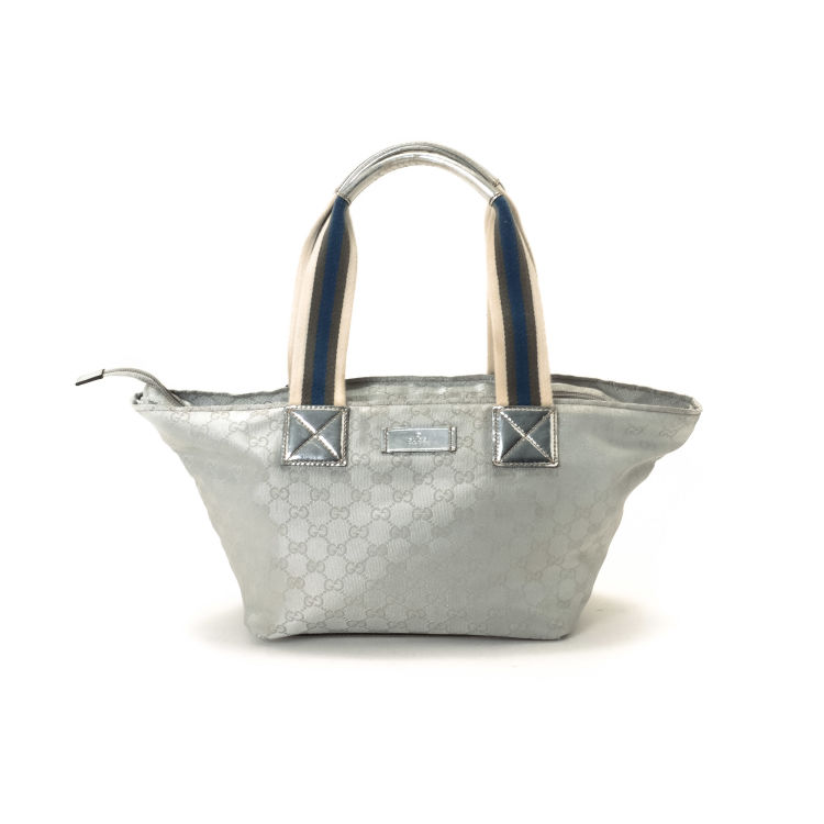 b5266bbb6e3f LXRandCo guarantees the authenticity of this vintage Gucci tote. This  classic tote was crafted in gg canvas in silver tone. Due to the vintage  nature of ...