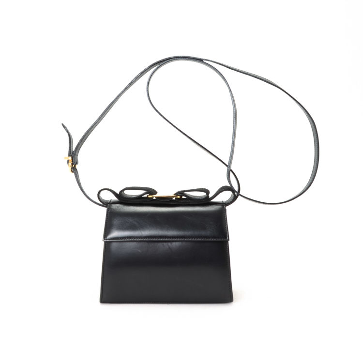 7ea0f1969e68 LXRandCo guarantees the authenticity of this vintage Ferragamo Vara Bow Mini  Two Ways Bag messenger   crossbody bag. Crafted in leather