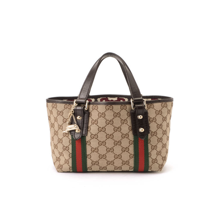 22a828c11494 LXRandCo guarantees this is an authentic vintage Gucci Mini Jolicoeur Bag  tote. This refined large handbag was crafted in gg canvas in beige.