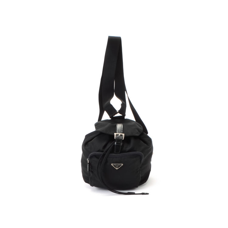 aab7a2494d20 LXRandCo guarantees this is an authentic vintage Prada Tessuto Mini  Backpack Bag travel bag. This refined baggage comes in beautiful black nylon .