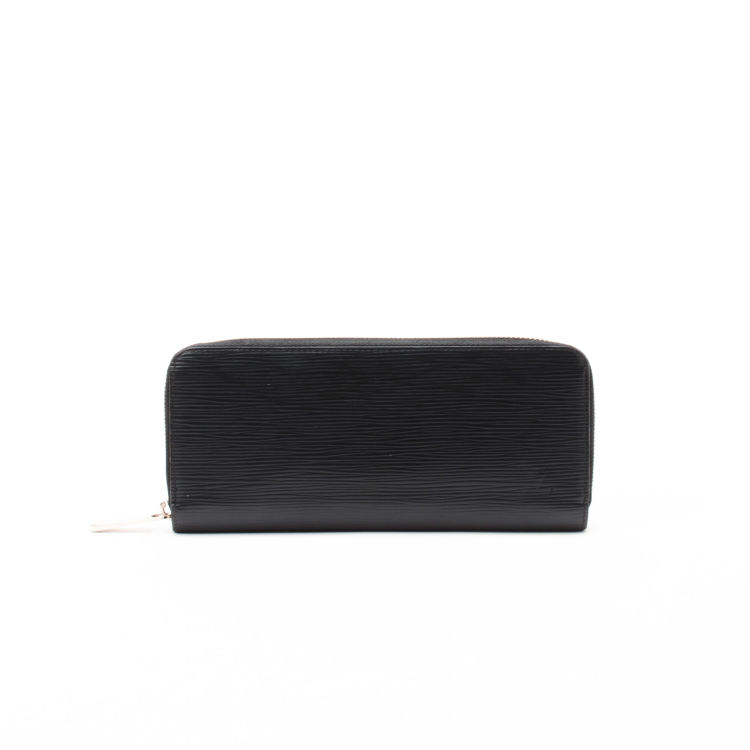 6349d29fb7038a LXRandCo guarantees this is an authentic vintage Louis Vuitton Zippy wallet.  This everyday card holder was crafted in epi leather in black.