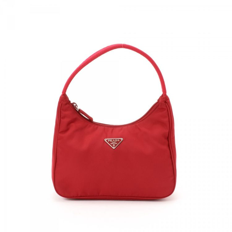 e88ef6bd41 LXRandCo guarantees the authenticity of this vintage Prada Tessuto handbag.  This everyday bag comes in beautiful red nylon. Very good condition  (A)