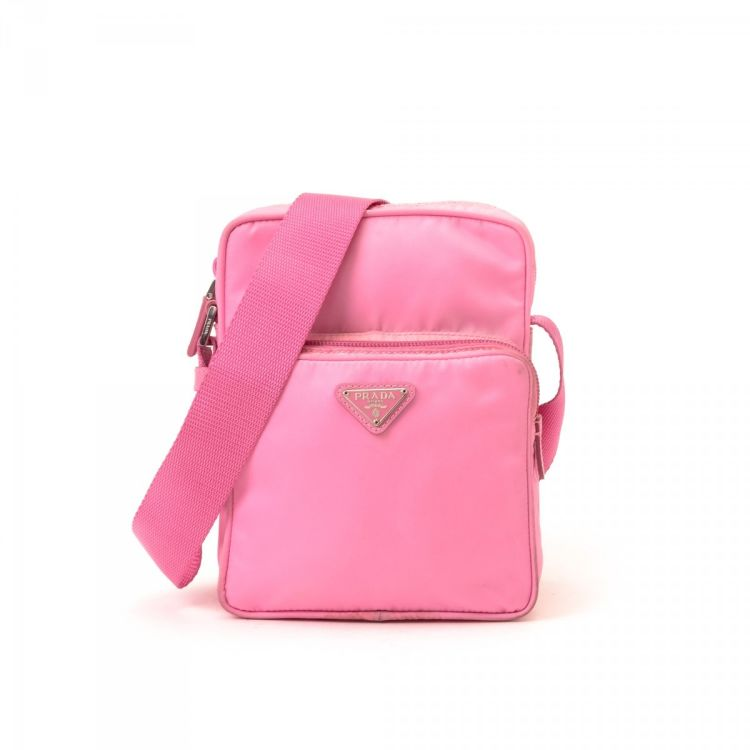 09c57e54538f LXRandCo guarantees the authenticity of this vintage Prada Tessuto  Crossbody Bag shoulder bag. This lovely bag was crafted in nylon in  beautiful pink.