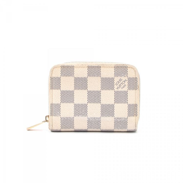 167eb628892a LXRandCo guarantees this is an authentic vintage Louis Vuitton Card Holder  wallet. Crafted in damier azur leather
