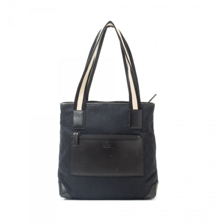 2652b38f966 LXRandCo guarantees this is an authentic vintage Gucci Bag tote. This  lovely large handbag in black is made in gg canvas. Due to the vintage  nature of this ...