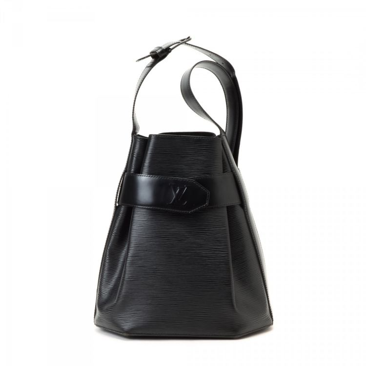212d43df0108 LXRandCo guarantees the authenticity of this vintage Louis Vuitton Sac  D epaule shoulder bag. This chic purse was crafted in epi leather in  beautiful black.