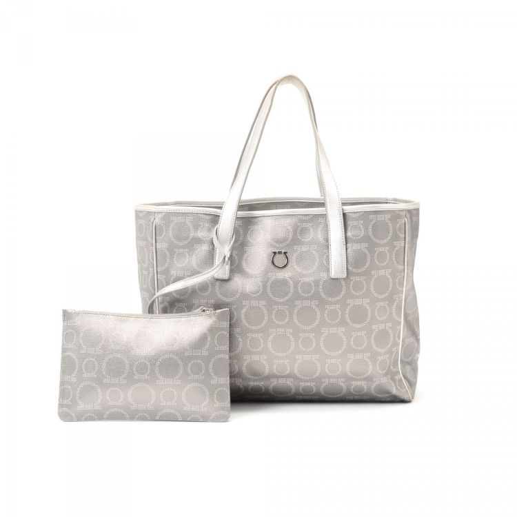 adb03475271 The authenticity of this vintage Ferragamo tote is guaranteed by LXRandCo.  This practical large handbag in silver tone is made in gancini coated canvas .