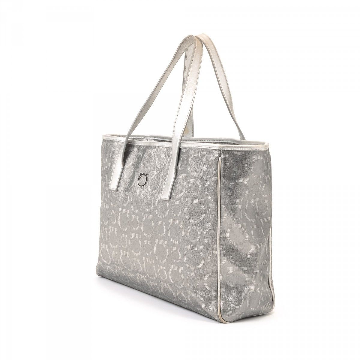 8fef2b7e249 Ferragamo Tote. The authenticity of this vintage Ferragamo tote is  guaranteed by LXRandCo. This practical large handbag in silver tone is made  in gancini ...