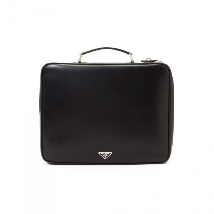 6e0cebfd7330 LXRandCo guarantees this is an authentic vintage Prada Business Bag  briefcase. This luxurious travel briefcase was crafted in saffiano calf in  black.