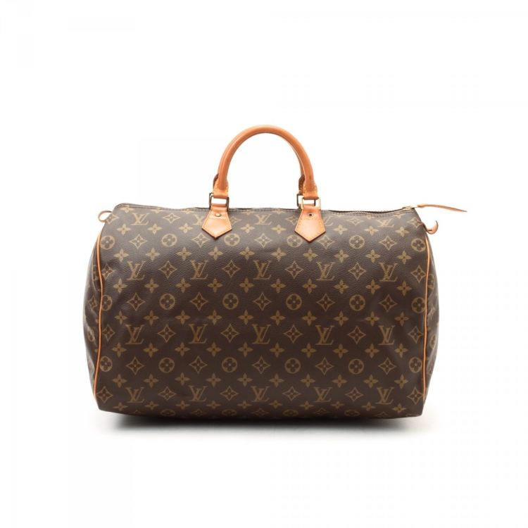 f68dba4f3b82 LXRandCo guarantees this is an authentic vintage Louis Vuitton Speedy 40 travel  bag. This sophisticated carryall was crafted in monogram leather in brown.