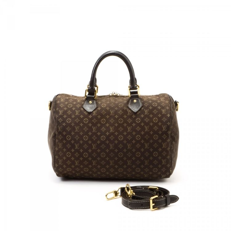 48b75647a281 The authenticity of this vintage Louis Vuitton Speedy 30 Bandoulière travel  bag is guaranteed by LXRandCo. This practical boston bag was crafted in  monogram ...