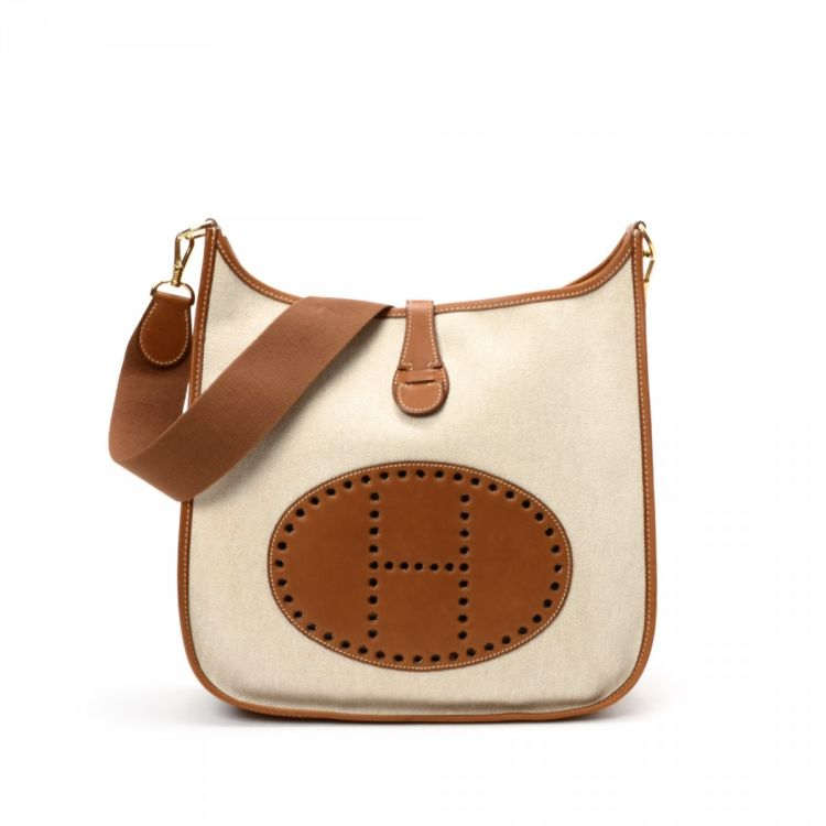 8646c04c017c The authenticity of this vintage Hermès Hermes Evelyne shoulder bag is  guaranteed by LXRandCo. Crafted in evelyne gm canvas