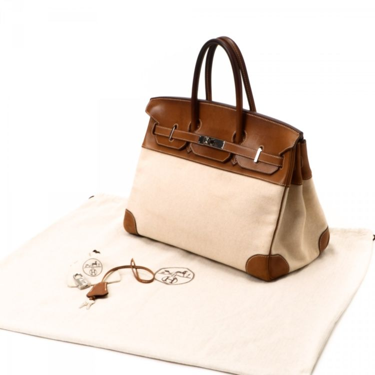 107dac24b768 The authenticity of this vintage Hermès Birkin 35 Toile handbag is  guaranteed by LXRandCo. Crafted in veau barenia canvas and leather