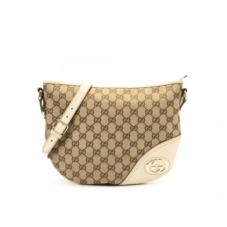 7d10764fb3b5 ... guarantees this is an authentic vintage Gucci New Britt Crossbody Bag  messenger & crossbody bag. This stylish hobo bag in beige is made in gg  canvas.