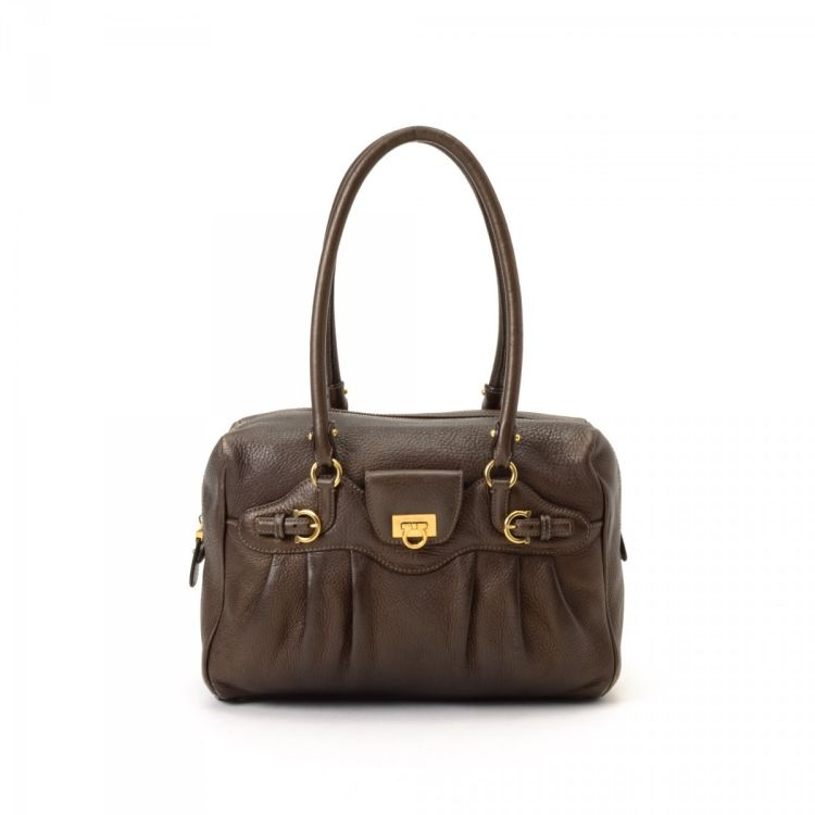 ae25403ddb2b LXRandCo guarantees this is an authentic vintage Ferragamo shoulder bag.  This signature shoulder bag in bronze is made in gancini leather.