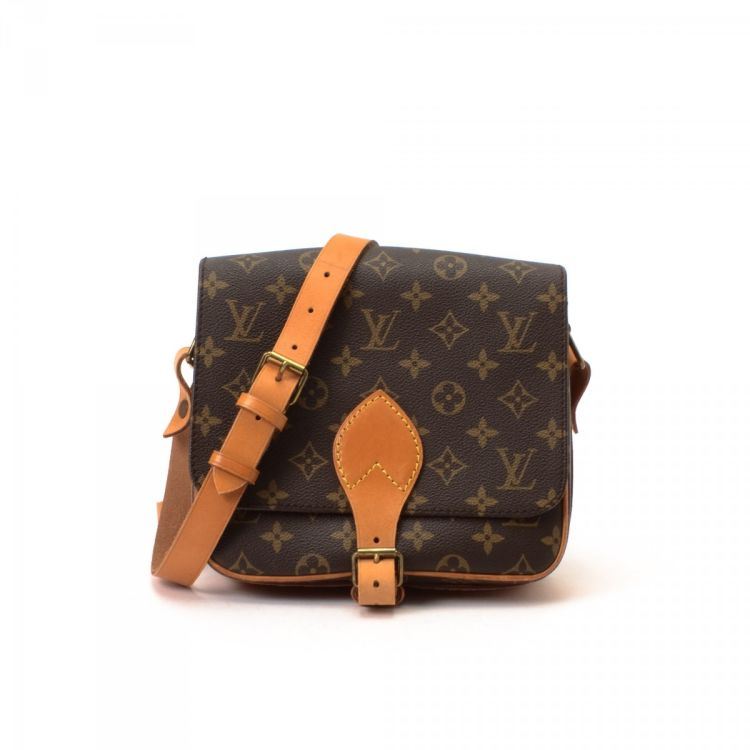 73ecfc523f LXRandCo guarantees this is an authentic vintage Louis Vuitton Cartouchiere  MM shoulder bag. This chic pocketbook was crafted in monogram coated canvas  in ...