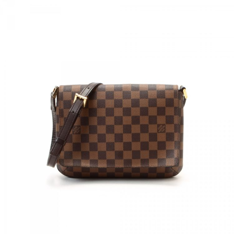 ac480a53dd4f The authenticity of this vintage Louis Vuitton Musette Tango Long Strap shoulder  bag is guaranteed by LXRandCo. This lovely purse in brown is made in damier  ...