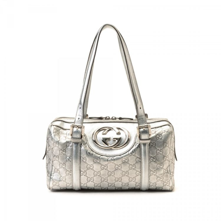 c513425a03755d LXRandCo guarantees the authenticity of this vintage Gucci Britt handbag.  This luxurious purse was crafted in guccissima leather in beautiful silver  tone.