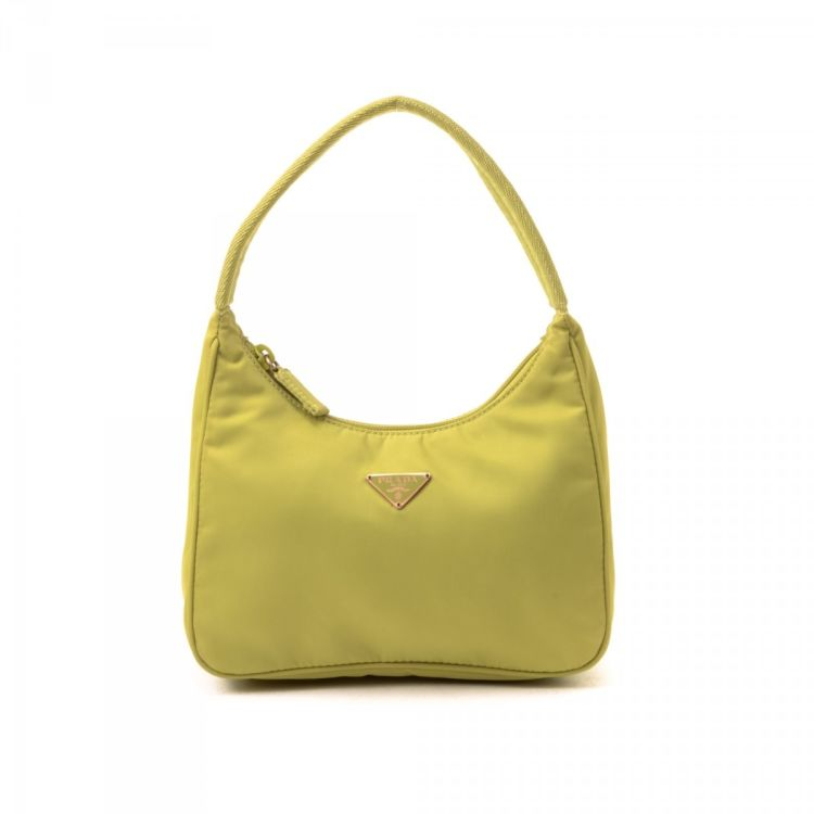 c2515250ab4b LXRandCo guarantees this is an authentic vintage Prada Tessuto Hobo Bag  shoulder bag. This luxurious shoulder bag was crafted in nylon in green.