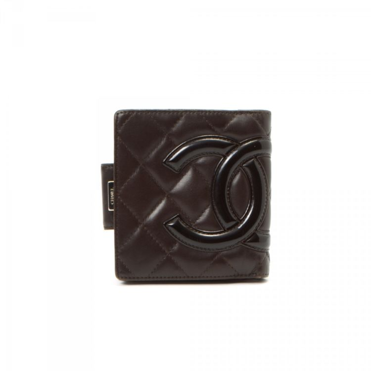 26d9753670b0 The authenticity of this vintage Chanel Cambon Small Quilted French wallet  is guaranteed by LXRandCo. This signature compact wallet in brown is made  of ...