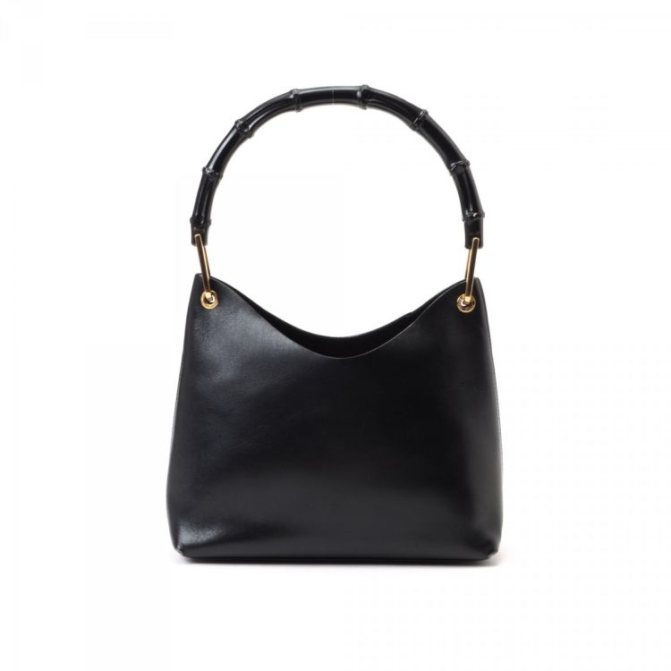 4f129896e13 LXRandCo guarantees the authenticity of this vintage Gucci Bamboo Hobo Bag  shoulder bag. Crafted in leather