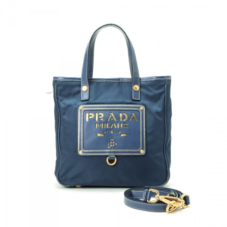 65b6179d5dd LXRandCo guarantees the authenticity of this vintage Prada Tessuto Two Way Bag  handbag. This iconic purse was crafted in nylon in blue.