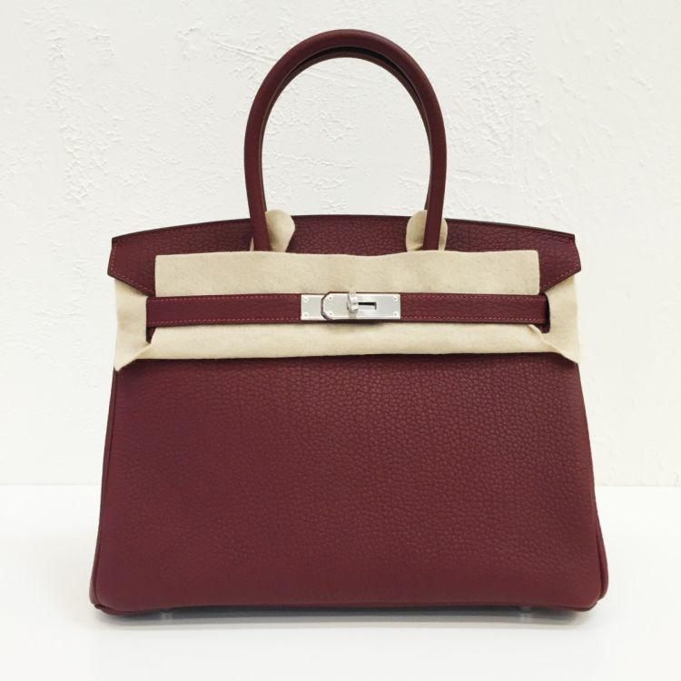 c2e83bb86d LXRandCo guarantees this is an authentic vintage Hermès Birkin 30 Rouge H  Togo PHW handbag. This practical bag comes in rouge h leather.