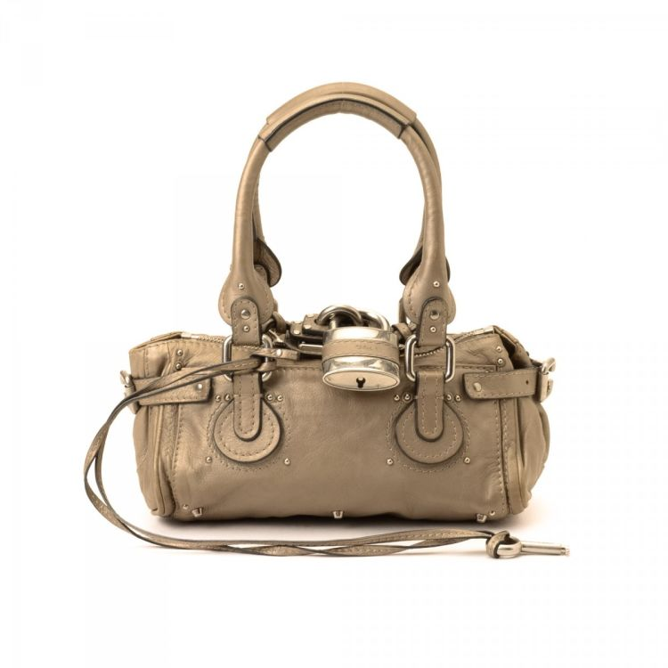 eaf2697693 LXRandCo guarantees this is an authentic vintage Chloé Paddington Mini  handbag. Crafted in leather