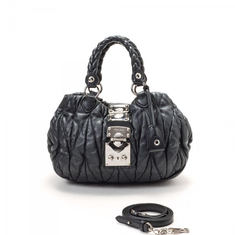 LXRandCo guarantees this is an authentic vintage Miu Miu Coffer Bag handbag.  Crafted in lambskin a7a491af92ef8