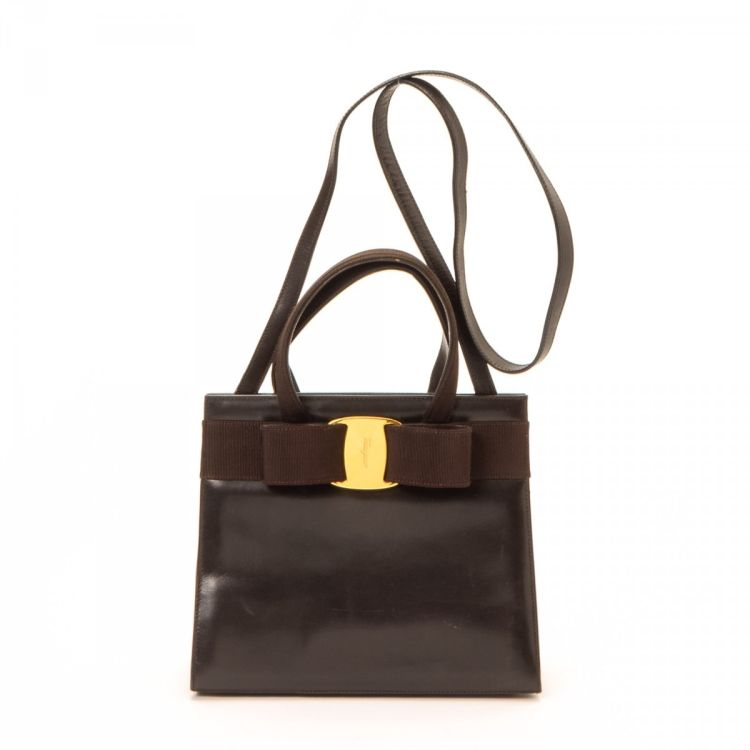 The authenticity of this vintage Ferragamo Vara Bow Two Way Bag handbag is  guaranteed by LXRandCo. This elegant purse in dark brown is made of leather. d973a69678135