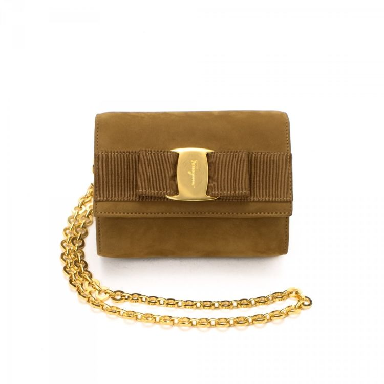 LXRandCo guarantees this is an authentic vintage Ferragamo Vara Bow Two Way  Pouch vanity case   pouch. This stylish makeup case in beige is made of  suede. c120d405f8575