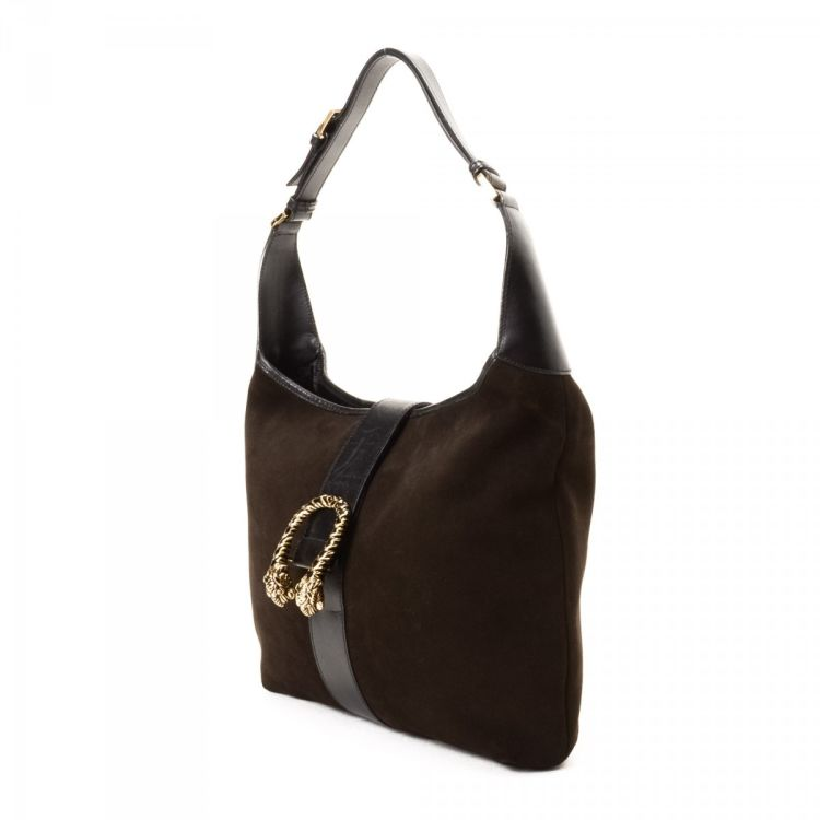 a2e98f0a7a0 LXRandCo guarantees the authenticity of this vintage Gucci Tiger Head shoulder  bag. This everyday bag comes in dark brown suede. Due to the vintage nature  ...