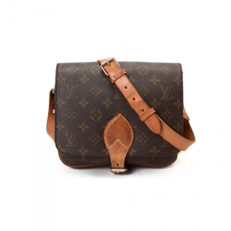 dca0c5defb LXRandCo guarantees this is an authentic vintage Louis Vuitton Cartouchiere  MM shoulder bag. This exquisite purse was crafted in monogram coated canvas  in ...