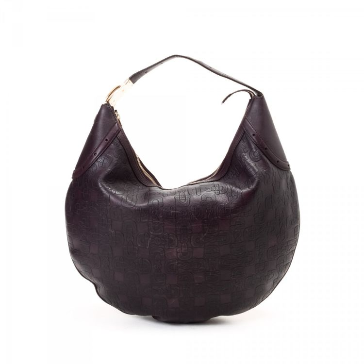 8d0e969ca4b The authenticity of this vintage Gucci Glam Hobo Bag shoulder bag is  guaranteed by LXRandCo. This chic purse was crafted in leather in purple.